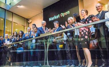 Image: Commissioner Jonathan Hill (fifth from the right in the first row) chairs the opening ceremony of the London Stock Exchange, London, 2 October 2015.  © European Union