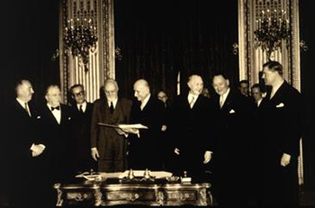 image for Treaties page: Robert Schuman and colleagues signing contract on 9.5.1950